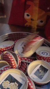A letter game for kids made from baby food bottle covers and can also fish by magnet!