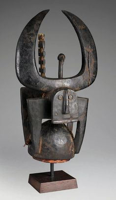 Africa | Helmet mask from the northern Tussian or Siemu people of Burkina Faso | Wood, cane and fiber robes