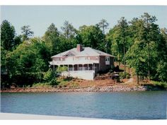 View photos, maps, and learn more about 149 Lakemont Drive located in Dadeville AL 36853 or search for additional homes for sale in Dadeville on Waterfront Property For Sale, Boat House, Heat Pump, Car Garage, View Photos, Geo, Decks, Baths, Hardwood Floors