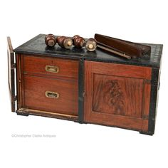 A teak and painted deal Aldershot or Hut Campaign Chest. The Army & Navy's catalogue of 1883 describes this type of chest as a 'Brass-mounted Chest of Aldershot or Hut Drawers. Stow On The Wold, Campaign Furniture, Sit On Top, Small Drawers, Army & Navy, Teak, Two By Two, Antiques, Antiquities