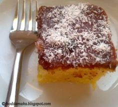 A crunchy layer of coconut on top with a sweet strawberry jam