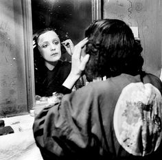 Edith Piaf by Maurice Chevalier in her green room in New York, 1947