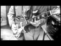 "Les Paul on guitar in ""How High the Moon"" with Mary Ford 1951 Multitrack Recording, Number One Song, Chet Atkins, Brian Wilson, Sgt Pepper, Best Guitarist, Cigar Box Guitar, Rock Legends, Types Of Music"