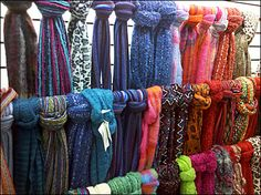Longer scarves could be used as a backdrop using a simple PVC pipe frame.like a curtain of crochet behind the table. Craft Show Displays, Window Displays, Display Ideas, Scarf Display, Scarf Holder, Ethnic Print, Merchandising Displays, Long Scarf, Gypsy Style