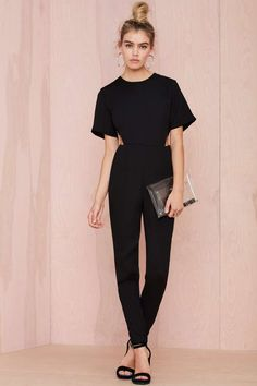 We're trying to get on your good side with this black canvas jumpsuit by Asilio.