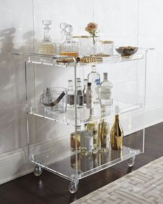 I am totally loving the bar cart trend right now. It is such a chic and retro way to decorate your home. Not only does it work as a decor piece, but it's also practical as well, storing your most used bar items. Check out my tips on how to start your own Home Bar Decor, Bar Cart Decor, Retro Home Decor, Vintage Decor, Vintage Style, Acrylic Furniture, Plywood Furniture, Lucite Furniture, Bar Furniture