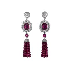 High Jewellery earrings Earrings - platinum, 6.03-carat and 7.01-carat oval-shaped rubies from Mozambique, cabochon-cut and faceted ruby beads, rose-cut diamonds, calibré-cut diamonds, brilliant-cut diamonds. The convertible pieces can be worn several ways.