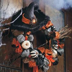 This Halloween wreath is made from fake gourds; I'd love to do one with dried and decorated gourds.  That witch's hat is so cool, and could be made from a gourd as well.