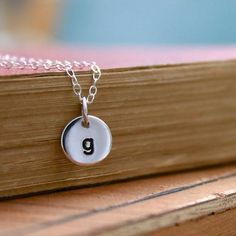 A simple round sterling silver initial charm on a sterling chain makes this a go-with-anything necklace. Personalize it by choosing any initial(s).  Each charm is stamped, blackened, cleaned and polished by hand. Great for bride, bridesmaids, graduate, mother, and grandmother.