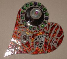 Stained glass and mixed media heart: I have been doing mosaic's for only a short time. I love doing abstract work....this if one of my earlier ones.