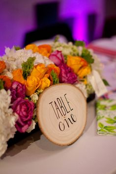 wood slice table numbers // photo by Natalie Bray Photography // http://ruffledblog.com/the-notwedding-san-diego