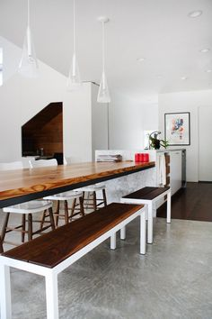 Modern Kitchen Bench love this use of ceasarstone and incorporating the dining table