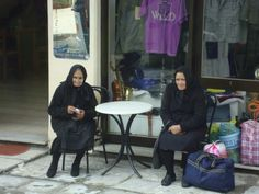 women at a bus stop  Kalambaka, Greece