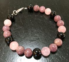 Depression, Anxiety, Self Esteem, Love & Stress Bracelet Listing is for one bracelet made with Rose Quartz, Lepidolite, and Black Tourmaline 8mm gemstone beads. Please note that you need to measure yo
