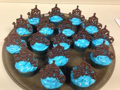 Cinderella Coach cupcakes...hand piped Cinderella coaches in chocolate