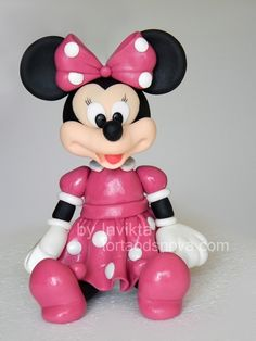 Minnie Mouse made of fondant (Minnie will always remind me of my granddaughter--played lots of Minnie and Mickey adventures with her)