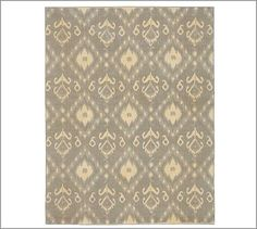 This is the rug i am thinking for the livingroom. The pattern is more subtle in person. It also has gray and blue tones in it. The offwhite is lighter and less yellow than the picture. Its also a flatweave rug.  Zonia Ikat Dhurrie Rug #potterybarn