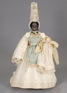 French nurse doll, 1850s-1860s. Unusual to see an African American version.