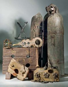 Various neo-medieval torture instruments. An iron maiden stands at the right.