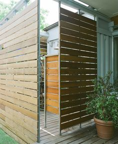 Outdoor shower in a shipping container house by designer Christopher Robertson.
