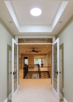"""Dark hallway solution #2 - """"If a large rectangular skylight isn't possible, try a tubular skylight. This is often an inexpensive way to dramatically increase the amount of natural light a dark hallway receives."""""""
