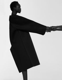 Minimalist Tailoring - black coat with clean lines & sleek silhouette; minimal fashion // Peter Do
