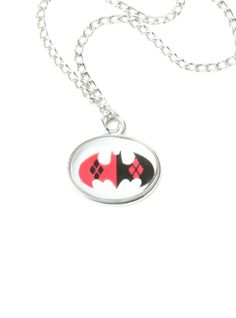 Necklace with a Harley Quinn inspired Batman logo pendant.