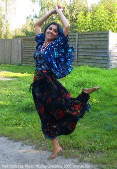 Romani Gypsy dance in native Romani costume. Dancing barefooted Gypsy girl