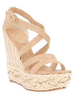 Nude/Tan Strappy Wedge sandals with a weave on part of the back heel. The very bottom part of the shoes are woven straw/mesh.