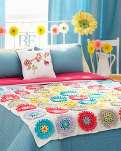 Colorful crocheted motifs make this afghan and pillow set a charming addition to any room! Shown in Waverly for Bernat.
