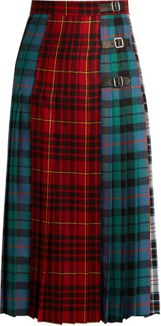 GUCCI Tartan wool skirt - This pleated wool skirt debuted on Gucci's Resort 2017 runway and is a luxurious take on a classic. It's patterned with clashing tartan panels in shades of red green white and black and detailed with three black adjustable buckle-fastening leather straps at the waist for a punkish feel. Style it with one of the label's mismatching blouses for an eclectic yet ladylike look.
