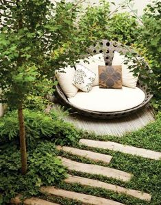 http://www.flamingpetal.co.nz/wp-content/uploads/2012/07/backyard-chair.jpg - Love the chair in the cozy nook! Love the path.