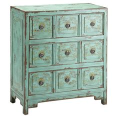 Hand-painted chest with 3 drawers and faux apothecary-style facings.   Product: Chest Construction Material: W...