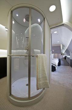 The Jumbo Jets Boeing and Airbus Turn Into Posh Private Planes | Part of this Boeing jet's master bedroom suite is the full shower. Boeing | WIRED.com