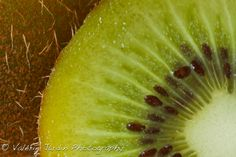 Beautiful color and composition in this macro photograph of a kiwi.