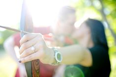 Omg. This is how I pictured one of my engagement photos to be.. except it would be of my shooting arm since I shoot left-handed =] *great minds think alike* Archery engagement picture