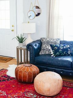 blue couch decor traditional living room design with navy blue leather couch navy nail button accents navy nail button accents and red pattern carpet dark blue sofa living room ideas 3 Living Rooms, Boho Living Room, Living Room Remodel, Rugs In Living Room, Living Room Designs, Living Room Decor, Bohemian Living, Modern Bohemian, Boho Chic