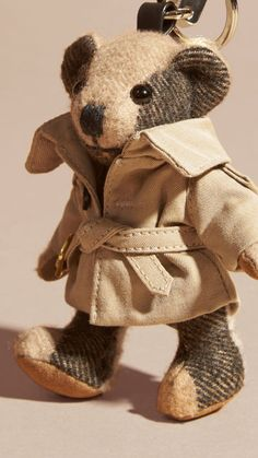 A charm featuring Thomas Bear, Burberry's signature teddy, in soft check cashmere. The design features moveable arms and legs, and a cotton trench coat.