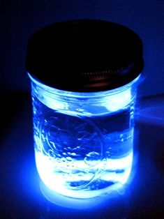 Put a glow stick in a mason jar full of water to make a latern