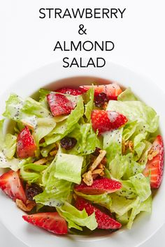 This scrumptious salad is a winning combination of crisp lettuce, scarlet strawberries and sugared almonds, all coated in a sweet-and-sour poppy seed dressing. #BiteMeMore #recipes www.bitememore.com