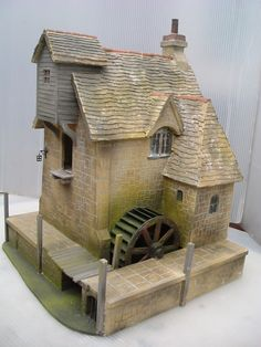 Period dollhouse with water mill,great brick detail