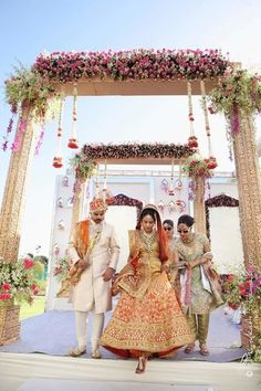 Peach and gold ombre lehenga , bride walking out of mandap