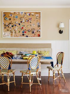 """No formal airs here. Laid-back is the vibe in the breakfast nook. A fun chrome and stone table sidles up to a long banquette bench and woven bistro chairs. Hints of blue and yellow say """"fun,"""" while yummy oatmeal and creamy white neutrals are as unfussy as they are timeless. Brooke and her family use the space for everything -- from meals in the winter to late night games or jigsaw puzzles in the summer."""