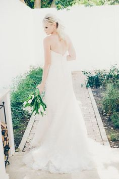 Bride with tulip bouquet | SouthBound Bride | http://www.southboundbride.com/contemporary-green-white-wedding-at-kleinevalleij-by-fiona-clair | Credit: Fiona Clair