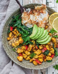 This farmers market vegan breakfast bowl is loaded with scrambled tofu, baked hash browns, and quinoa to fuel you up for the day!
