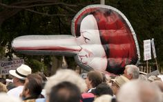 A pinnocchio-nosed inflatable Julia Gillard at the Sydney No Carbon Tax rally, Hyde Park, Sydney, 2 April 2011