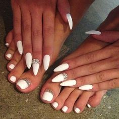 white nail paint manicure and pedicure with swaroski crystals... diamante. HATE the pointy nails lol