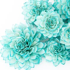 These teal wooden flowers are perfect for bridal showers, weddings, baby showers, as centerpieces at dinner parties or as an extra elegant touch in home decor. Resembling a blooming Dahlia, these flow