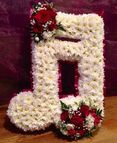 A lovely tribute for a member of the local brass band by Liberty Bloom Florist using Val Spicer 'Double Note' Grave Flowers, Cemetery Flowers, Funeral Flowers, Funeral Floral Arrangements, Flower Arrangements, Art Floral, Floral Design, Blooms Florist, Cemetery Decorations