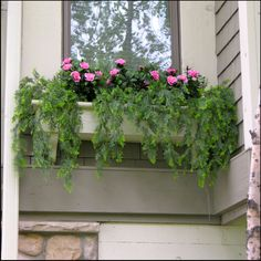 Faux vines and flowers in a window box